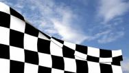 Stock Video Footage of Checkered flag against blue sky