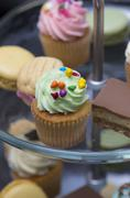A delicious mini cupcake with green icing - stock photo
