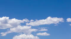HD tight 30p Cumulus clouds come and go while stationary over mountain Stock Footage