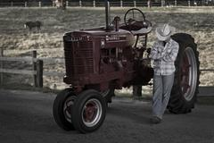 Cowboy and his tractor - stock photo