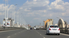 Driving on the bridge named after the sixtieth anniversary of victory. omsk. Stock Footage