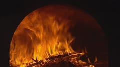 Wood-burning fire in brick kiln Stock Footage