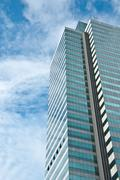 High rise building with blue sky Stock Photos