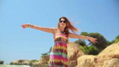 Happy excited young woman turning round by the sea HD Stock Footage