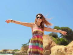 Happy excited young woman turning round by the sea NTSC Stock Footage