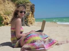 Happy woman wil laptop on beautiful beach NTSC Stock Footage