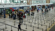 Stock Video Footage of Airport terminal day. Wide shot. Passengers check in area