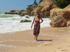 Beautiful young woman walking on exotic beach NTSC Stock Footage
