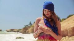 Young happy woman using smartphone by the sea HD - stock footage