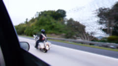 Surreal motorcycle in road color 1 Stock Footage