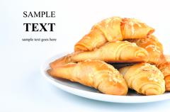 little croissants with ham and cheese - stock photo