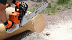 Chainsaw cutting Stock Footage