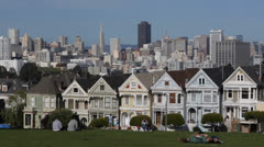 Alamo Square Park, Famous Victorian Row Houses in San Francisco with skyline Stock Footage