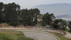Bicyclist riding around Twin Peaks in San Francisco Bay Aerial View Skyline Stock Footage