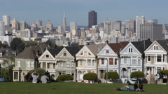 Famous Victorian Row Houses in San Francisco with skyline, Painted Ladies - stock footage