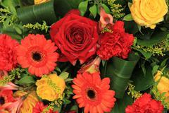 red, yellow and orange wedding decorations - stock photo
