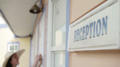 A woman knocks on the closed door of a reception Stock Footage
