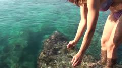 Rinsing teeth with salty sea water Stock Footage