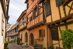 timbered houses in the village of eguisheim in alsace, france - stock photo