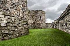 beaumaris castle walls on the isle of anglesey in north wales - stock photo