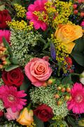 mixed flower arrangement in bright colors - stock photo