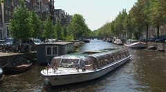 Pan from canal boat in Amsterdam Stock Footage