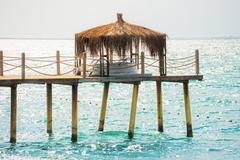 Pier with a bungalow Stock Photos