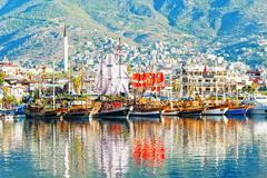 Dinghies on the waterfront of the city of Alanya. Stock Photos