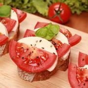 fingerfood with mozzarella cheese and tomatos - stock photo