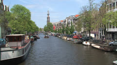 Pedalo and boat in Amsterdam canal Stock Footage