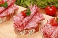 fingerfood with salami - stock photo