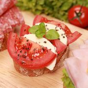 fingerfood with mozzarella cheese and tomatoes - stock photo