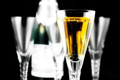 Champagne Flutes and Bottle on Black Stock Photos