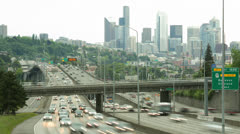City commuter traffic freeway cars driving skyline time-lapse - stock footage