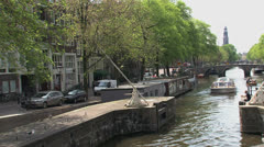 Canal boat in Amsterdam with the westertoren at the background Stock Footage