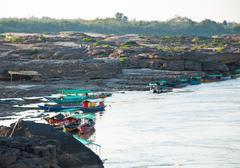 group of longtail boat for tourist at sam pan bok in ubonratchathani, thailan - stock photo