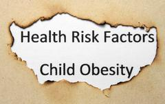 Health risk factors - child obesity Stock Photos