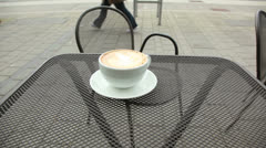 Cappuccino at a ourdoor cafe Stock Footage