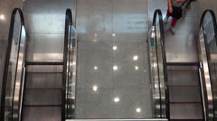 People taking escalator up and down in shopping mall Stock Footage