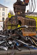 Stock Photo of scrap metal with grappler