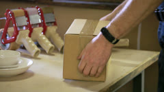 Packaging a box for shipping Stock Footage