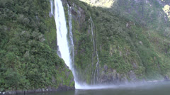 Boat approaches Stirling Falls, Milford Sound Stock Footage