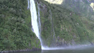 Stock Video Footage of Boat approaches Stirling Falls, Milford Sound