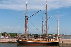 Wooden sailing vessel in the port Stock Photos
