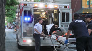 Paramedics loading woman into Ambulance Stock Footage