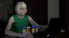 Mature woman, prescription medication Stock Footage