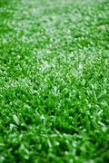 the astroturf for soccer as background - stock photo