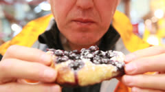 Man enjoying a blueberry tart Stock Footage
