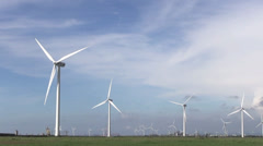 Row of  wind turbines generating clean  energy in the countryside Stock Footage
