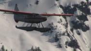Stock Video Footage of Alaska Float Plane Across Mountains Slow Motion